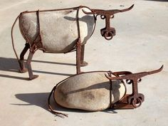artpropelled:  The Thundering Herd byWilhelmsArt(Cattle made from river rock, railroad spikes, railroad track, steel wire, and nuts)