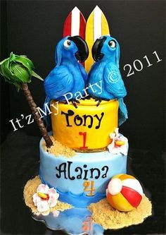 This is one of my favorites! Both birds were made from RKT, covered in chocolate and finished in fondant. Beachball was made from RKT covered in fondant, and the surf boards were made from gumpaste.