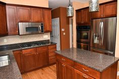 Kitchen with It has maple cabinets, granite countertops and two islands. It also includes stainless steel appliances, a built-in wine rack and double ovens.
