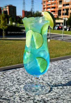 Blue Peach on the Beach Cocktail - For more delicious recipes and drinks, visit us here: www.tipsybartender.com