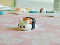 Nyan~! This kawaii sushi cat (similar to the Musubi Cat) is made out of clay and will come on a phone charm