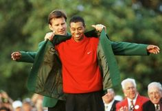 1997 Tiger Woods being fitted for the first of four Green Jackets by Nick Faldo, Augusta Nationals