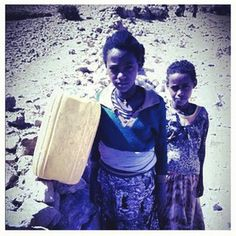These young girls walked two hours to the nearest water source today in Ethiopia. (Photo credit: Shakil Khan.)