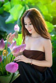 Beautiful Women With Flowers