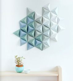 Paper wall sculpture made with Canson paper and a downloadable pyramid template from Knot Magazine