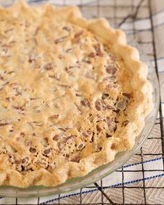 """""""Run for the Roses"""" Pie - This dessert, named after the race's nickname which refers to the blanket of roses draped over the winning horse, is a unique variation on traditional Derby pie. Here, a buttery crust loaded with pecans and chocolate are mellowed by bourbon."""