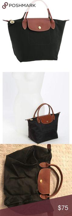 Longchamp 'mini le pliage' handbag Longchamp 'mini le pliage' handbag. Black. Excellent condition. Longchamp Bags Mini Bags