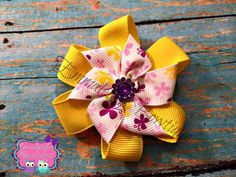 A personal favorite from my Etsy shop https://www.etsy.com/listing/266097588/flower-and-butterfly-hair-bow-yellow