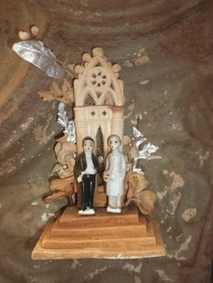 Vintage aged Cathedral Inspired Bride and Groom Wedding Cake Topper via Etsy.