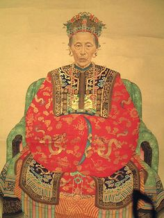 A large and finely painted Chinese portrait of the Empress Dowager, Cixi, in ink, bright colours and gilt on paper. Mounted as a hanging scroll. Circa 1900. The Empress Dowager, Cixi or Tsu-Hsi, was the concubine of the emperor Xianfeng and, on his death in 1861 effectively ruled China until her death in 1908