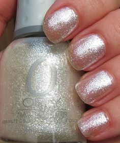 Body and Soul: Orly 'Tis the Season Part II: Naughty or Nice, Glitz & Glamour, Winter Wonderland the silver added with the white gives a subtle yet sparkly look.
