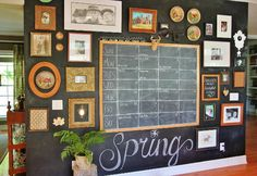 loving this chalkboard wall full of collected special things and a big chalkboard schedule for her family