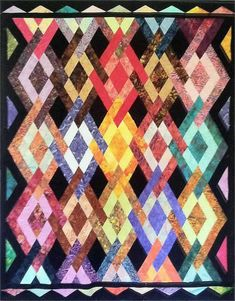 Pattern designed by Reeze LaLonde Hanson - Morning Glory Designs. Peggy's Diamonds Quilt Pattern MGD-111 (intermediate, throw, lap)