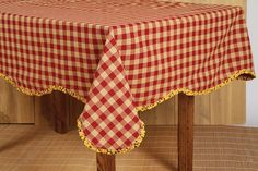 CLOSEOUT SALE!  Cambrie Lane Scalloped with Ruffle Table Cloth 60x80 - This table cloth is a made out of a 100% cotton.