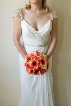 Bouquet with coral Germinis, Roses and Miss Piggy Roses. Wedding Dress