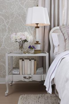 Love the wallpaper, and curves in the furnishing, waht a pretty but modern room. Traditional elements with a modern take. sarah richardson sarah 101 neutral bedroom mauve