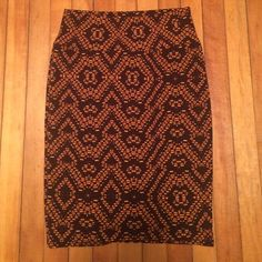 LuLaRoe Cassie Brown and orange LuLaRoe Cassie. Worn twice and washed per LLR instructions. So cute! In perfect condition. Just need to make room for my LuLaRoe addiction :) LuLaRoe Skirts Pencil
