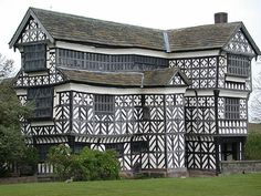 Little Moreton Hall-The south wing was constructed circa 1570, late Tudor Era, one of the finest examples of timber-framed domestic architecture in England. The earliest parts of the house were built for the prosperous Cheshire landowner Sir Richard de Moreton around 1450; the remainder was constructed in various campaigns by three successive generations of the family until around 1580. The house remained in the ownership of the Moreton family for almost five centuries.