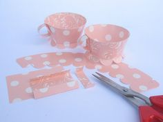 Tea Party Cupcake Wraps, Peach Pink Paisley / Polka Dot Patterns. Kit of 12 DIY Teacup Cupcake Wraps. 1 Personalized Cupcake Topper. $10.00, via Etsy.