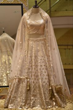 Bisque Applique Embroidered Net Bridal – Stylizone A beautiful blush pink gown with a heavily embellished bodice in pearls, beads, and sequins on the front and back. The gown has an irregular pearl spray, highlighting the outfit. Bridal Lehenga Online, Designer Bridal Lehenga, Indian Bridal Lehenga, Pakistani Bridal, Lehenga Wedding, Lehenga Style, Red Lehenga, Anarkali, Lehenga Blouse