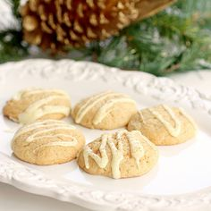 """Eggnog cookies.  Eggnog icing is fantastic.  Recipe calls for salted butter.  Remember to add salt when using unsalted.  Cookie scoop would come in handy on these ones, dough is too sticky to roll and doesn't round well in the oven.  Tastes like eggnog though.  Dev says, """"What did you use for eggnong flavor?""""  I say, """"Eggnog.""""  He says, """"Tastes like it."""""""