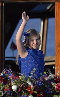 Catharina-Amalia, Netherlands' Princess of Orange waves as she takes part on 30 April 2013 in a water pageant on the river IJ in Amsterdam on the day of her father, King Willem-Alexander of the Netherlands' investiture