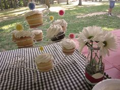 hand-dipped acrylic vases and cupcakes a la circus (pom poms on toothpicks)