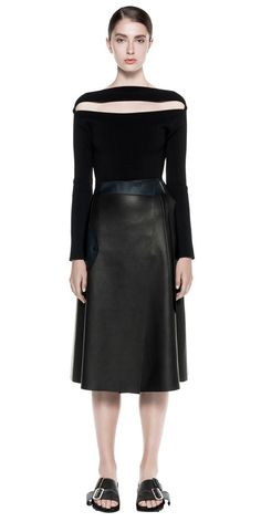 High waisted wrap a-line leather skirt constructed from a soft calf leather. Designed with a belted wrap waistband & finished with flap pocket detailing. Leather is double bonded with a navy contrast. Product Code: A1155\S17