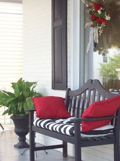 Pretty Porches - I love the black bench with the black and white cushion seat and the red pillows
