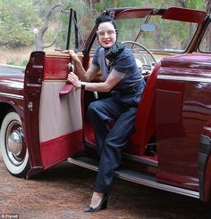 Stylish combination: Dita wore head-to-toe blue and fiery red lips to compliment her car