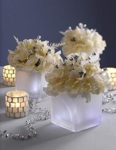 How to make a Lit Centerpiece - easy!  Step 1: Gather Flowers  Step 2: Choose Vases  Step 3: Create Bouquets  Step 4: Add Flameless Candles