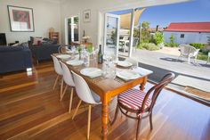 Open up the concertina doors and bring the outside in. Concertina Doors, Victoria Australia, Eat Sleep, Open Up, Table Settings, Dining Table, Boutique, Furniture, Home Decor