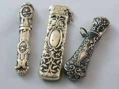 THREE STERLING SILVER NEEDLE CASES