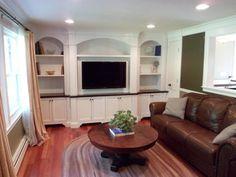 Entertainment Center:  flat panel doors, oak countertop, open adjustable shelving, arch detail, chamfered piilaster detail,  2 piece crown molding.