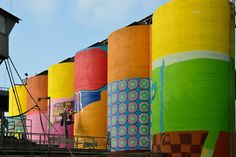 os gemeos colorizes six giant silos on vancouver's granville island