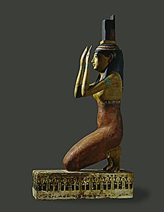 PTOLEMAIC PERIOD, EGYPT STATUE 4TH BCE  The Goddess Isis lamenting the death of her husband Osiris. She carries her iconographic hieroglyph on her head. Painted wood.