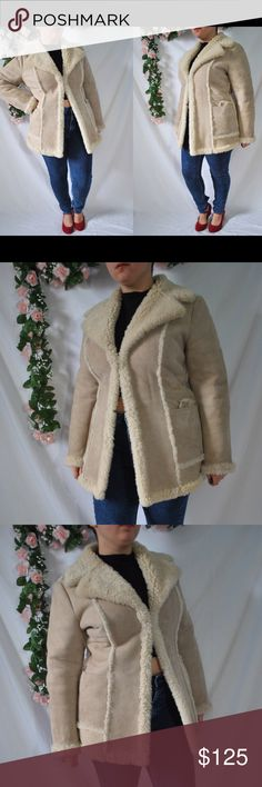 Vintage 70s Tan Suede Sheepskin Coat Made of authentic sheepskin.   The inside is lined with cozy sheep fur.   This coat will definitely keep you warm in the coming winter months!  *There are a few spots, nothing too noticeable.   Measurements. (Measured
