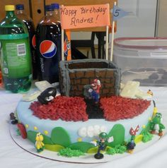 Andrea's Super Mario Wii Cake with white chocolate Wii remotes.