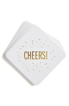 Ringing in the new year—while keeping the tables ring-free—with these festive coasters featuring a golden foil-embossed design.