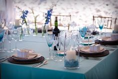 less is more- simple centerpieces= candles, stems of flowers