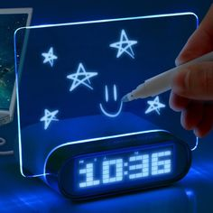 An alarm clock that lets you leave glowing blue memos (or drawings) on an illuminated panel. Certainly more attractive than a sticky note.  http://www.walletburn.com/Glowing-Memo-Alarm-Clock_791.html