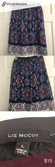 Liz McCoy Floral Elastic-Waist Skirt Fun and floral skirt, in great condition! Dark blue with light blue flowers, and additional pops of white and peach! Light, flowy material with an elastic waist. Size is large Liz McCoy Skirts