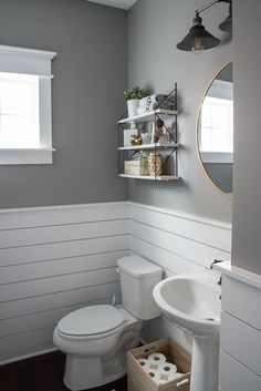 Check out this beautiful powder room reveal! This tiny bathroom was transformed … Check out this beautiful powder room reveal! This tiny bathroom was transformed from boring to fresh and modern! I love the shiplap and the modern classic decorations. Tiny Bathrooms, Upstairs Bathrooms, Downstairs Bathroom, Bathroom Stuff, Master Bathroom, Bathroom Gray, Bead Board Bathroom, Bathroom Wall Ideas, Mosaic Bathroom