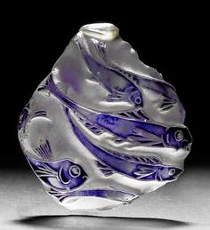 Lalique  1912 'Poissons' Pendant 4-cm-high tear-drop shaped glass w/an all-over fish design highlighted by blue enamel