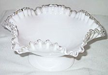 These are footed bowls with a ruffled edge in the Silver Crest pattern made by Fenton. They measure 8.5 inches across and are 4 inches high. These bowls are not marked and is in good condition with no