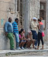 People in Center Havana narrow streets.