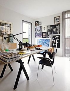 Don't you just love this office? Not only is the desk super sleek (& still functional), but the gallery wall is stunning! A lot of great work must happen here.