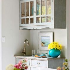 Cut a hutch in half - hang the top half on the wall.  Great Kitchen Storage Ideas | Traditional Home