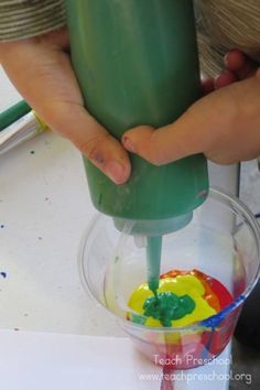 Rainbow swirl paint by Teach Preschool
