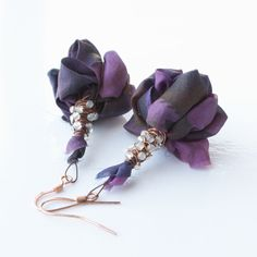 Elegant fabric earrings - violet silk and wire wrapped stone. $20.00, via Etsy.